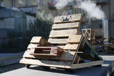 80*120's self-build workshop turns shipping pallets into street furniture