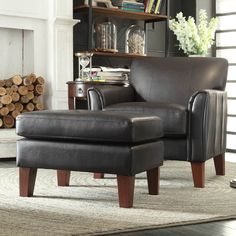 Add a welcome touch of modern detail to any room in your home with this faux leather chair and ottoman set. Upholstered in vinyl and crafted with premium-grade foam, these comfortable seats are plush, roomy, and extremely comfortable.
