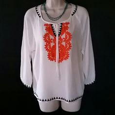 THML White BoHo Top W/Black and Orange Detail Cute top, light and flowy. The sleeves are a little longer than 3/4 length. Back and orange embroidered detail in the front, around the neck, botton and sleeves. Great condition. THML  Tops