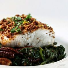 Tired of tilapia? Try pan-seared Mahi-Mahi with a warm, pecan-spinach salad.