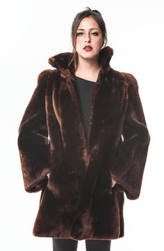 "This SUPREME Mouton Fur Coat will SUPREMELY fit your MAD budget!! This coat is SO SUPER Smooth...could be VELVET Late 60's Early 70's 3/4 Length Coat Straight Sleeve Length 32"" Cross Back 22"" Sleeve L"