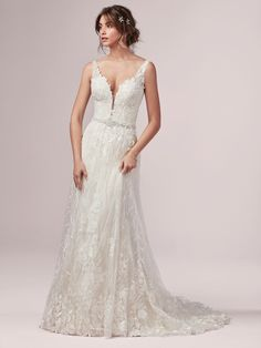 The definition of boho bridal romance: this gown features leaf patterned lace appliques over a textured sheer lace.