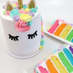 Classic unicorn cake that's just so darn cute!  #unicorn #cake #rainbow