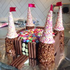Castle cake for my four year old girl's birthday. (Rice crispie towers for the…