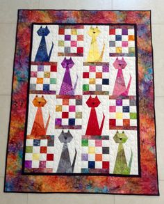 "Cat Quilt, made for Jenn and Yuri.  I titled it ""You Must be Kitten me! "".  I used colourful bright batik fabrics.  Pattern is Scrappy Cats by Carolyn Hughey *2014. Completed Jan 2015"