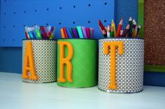 Use scraps to keep your office organized. Smaller wrapping paper pieces can be glued onto old paint cans or other tins to hold supplies.