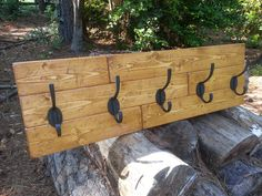 Rustic Coat Rack built from pine flooring planks. Perfect for that salvaged or reclaimed feel.  #reclaimedwood #rusticcoatrack #coatrack #entrywaydecor #mudroomideas #woodendecor #primitivedecor