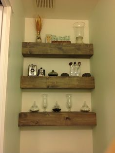 Love how the rustic shelves turned out with the pretty paint color to brighten up this tiny half bathroom