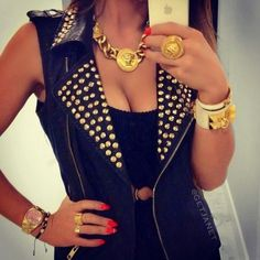 Black sleeveless vest with small gold hex studs on collar and lapels. Worn with chunky gold jewelry.. DIY the look yourself: http://mjtrends.com/pins.php?name=gold-hex-studs-for-clothing_1