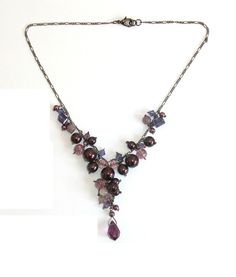 Purple Cluster Bridesmaid Necklace With Glass Pearls and Swarovski Crystals. $29.95, via Etsy.