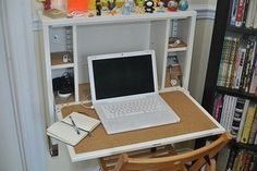 Wall-mounted fold-away laptop desk from Ikea.
