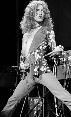 : Robert Plant - Iconic Images - - Robert Plant of English rock band Led Zeppelin during the May performance at Earls Court Exhibition Centre, London, UK, Robert Plant Young, Robert Plant Children, Robert Plant Wife, Robert Plant Quotes, Robert Plant Led Zeppelin, Jimmy Page, John Paul Jones, Music Background, Batman The Dark Knight
