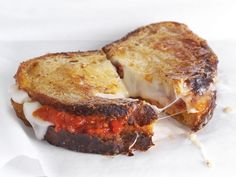 Spread pasta sauce between 2 slices of crusty bread and top with taleggio cheese; cook in a buttered skillet or panini press.