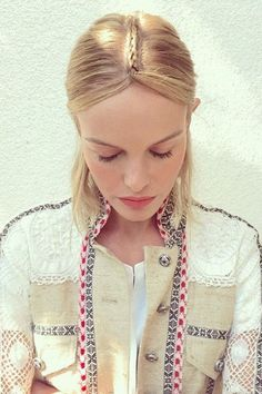 Hairstylist Bridget Brager created the actress's gorgeous braided headpiece by cornrow-ing a section of hair from the center up from the crown, parting it at the forehead and pinning it behind the ears. @katebosworth