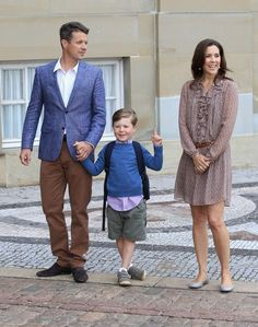 T.R.H.s Crown Prince Frederik and Crown Princess Mary along with the young prince Christian posed for hundreds of photographers and reporters outside of their home before the young prince was sent off to school.