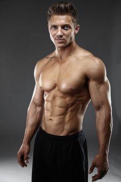 bryant wood fitness model in aronik swim suit  abs pecs