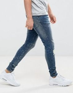 05a4eac57207 SikSilk Muscle Fit Jeans In Mid Wash With Distressing And Zips at asos.com