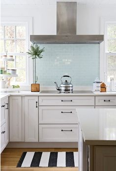 The Happy Home Project - traditional - kitchen - Becky Harris, white kitchen with pale blue glass tile backsplash, mint blue Glass Tile Backsplash, Kitchen Backsplash, Glass Tiles, Backsplash Design, Backsplash Ideas, Kitchen Cabinets, Tile Ideas, Splashback Tiles, Beadboard Backsplash