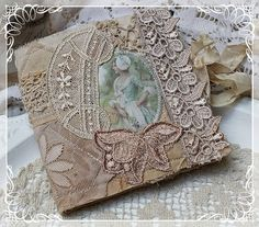 Shabby Chic Inspired: Needlecase ~ dig the lace motifs & fabric image… Hanging Fabric, Fabric Art, Fabric Books, Needle Case, Needle Book, Sewing Crafts, Sewing Projects, Crazy Patchwork, Crazy Quilting