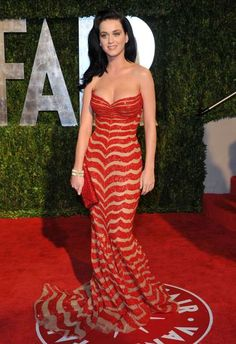 Katy Perry's Craziest Style Moments Katy Perry's In a dazzling red and tan-striped Zuhair Murad Couture gown at the 2010 Vanity Fair Oscar Party in West Hollywood. Katy Perry Images, Katy Perry Pictures, Russell Brand, American Idol, Katy Perry Hot, Katy Perry Dress, Katy Perry Gallery, Vanity Fair Oscar Party, Orange Dress