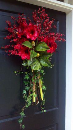Designed by Rick Butler/ Garden District. Beautiful #Christmas front door swag.
