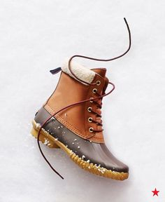 Duck boots have officially become a preppy style must-have and a top gift for the holiday season. A girl who appreciates looking cute in the cold will love these classic, faux fur lined boots by Tommy Hilfiger.