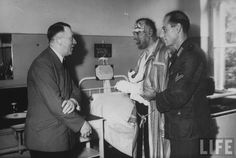 Hitler comes to visit one of the injured officers, after a failed assassination attempt on Hitler, July 20, 1944.