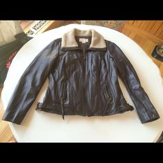 """Michael kors leather bomber motorcycle jacket xl This is a beautiful leather coat by Michael Michael Kors. It has a long sleeves and a zip up front with two zip pockets. The collar is a faux shearling fur and it is a size XL. It is 100% leather and lined. The leather feels soft like lambskin but the label doesn't indicate what kind of leather. dry clean only. It has two small scuffs and two raised stitches. See additional photos listing.  Shoulder to shoulder: 17"""" Arm pit to arm pit: 22""""…"""