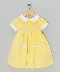 Take a look at this Lemon Polka Dot Hand-Smocked Dress  by Couche Tot on #zulily today!