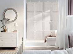 PAX white wardrobe with HEMNES white stained doors and HEMNES chest of drawers