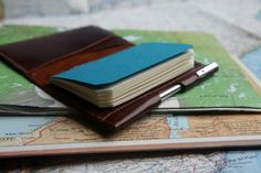 BankNote Minimalist Wallet with Notebook. A small, minimalist wallet paired with a notebook. Fits in front pocket. Vintage Italian leather. Small batches. Made in NYC.