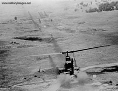 Google Image Result for http://www.militaryimages.net/photopost/data/716/Vietnam_War_Huey_Cobra_Firing_in_Support_of_a_Combat_Assault.jpg