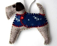 Handmade felt dog ornament for Christmas or any occasion. Fred and his friends are Airedale Terriers made from felt, with jolly buttoned jackets