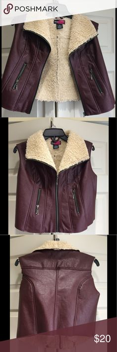 Beautiful women Vest This is a beautiful lightweight Faux Leather fur women Vest in excellent condition.                                      Material 100% Polyurethane Lining and 100% Polyester Say What? Jackets & Coats Vests