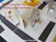 Neighborhood under construction in preschool WOW!!!  I've tried creating a neighborhood on a billboard with family photos of the children framed in house shapes, but the 3-dimensionality of this project, the ownership of the houses and the book by Gail Gibbons as a provocation is just brilliant!!!!