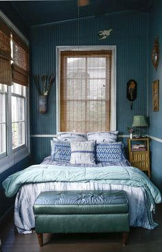 A small bedroom can still be soothing if you layer on the marine hues.