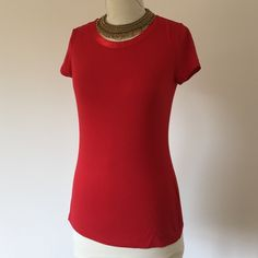 Banana Republic T-shirt ❤️ Red t-shirt with a pretty satin neckline. Soft and comfy material. The neckline is made of satin in the same color red. Elevated look, a better t-shirt. Wear with jeans and a heel. Sorry, no trades. Reasonable offers accepted. Banana Republic Tops Tees - Short Sleeve