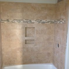 Carly's shower... New tile with accent piece.