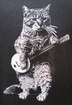 This cat can jam!  This banjo design shirt is printed on soft fabric with environmentally friendly water based ink that sets in the printing