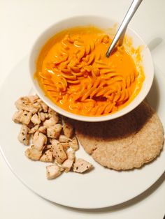Tomato soup with pasta - chicken, and bread.
