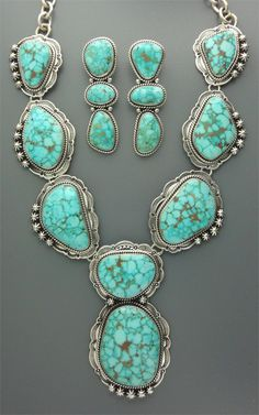 Necklace & earrings | Mike Thompson (Navajo).  Sterling silver and natural turquoise.
