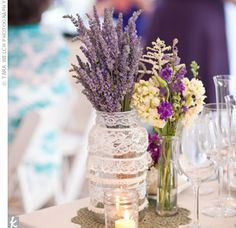 Mason jars, wrapped in tiers of lace and filled with lavender, added a romantic touch to the tables.