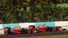 Max Verstappen (NED) Red Bull Racing RB12 and Daniel Ricciardo (AUS) Red Bull Racing RB12 battle for position at Formula One World Championship, Rd16, Malaysian Grand Prix, Race, Sepang, Malaysia, Sunday 2 October 2016.