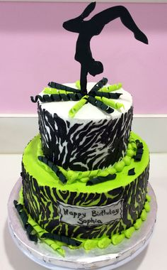 Dance or gymnastics themed cake with zebra print and neon green