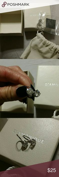 BNIB Diamonique 1 CT each CZ in .925 These have never even been tried on. They are gorgeous.  1 carat in each ear. Comes with box, pouch. Gorgeous set in .925 No trades no try on for hygiene purposes Diamonique Jewelry Earrings