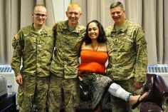 Linda Hartman with heroes Spc. Joshua April, Sgt. Mike Black and Sgt. First Class Todd Richter. Photo: Ashley Alameda