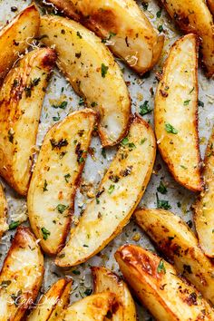Crispy Garlic Baked Potato Wedges | Cafe Delites | these are soft pillows on the inside, and crunchy on the outside with a good kick of garlic and parmesan cheese!