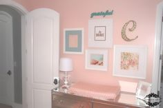Gallery wall in pink nursery