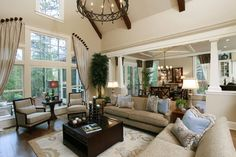 Dream house style: love the sunken living room, vaulted ceilings, and really like how the window treatment was done.