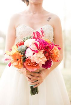 A Vibrant Pink-and-Orange Bouquet of Ranunculus, Peonies, Poppies, and Dahlias Pink Wedding Bouquets